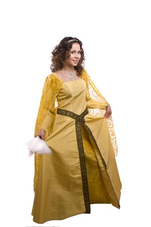 Woman wearing fancy yellow dress on Halloween. A young woman dressed up as princess make curtsey. Cute girl in medieval era costume on white background. Stock Photo - 5769206
