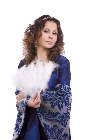 Woman wearing fancy blue dress on Halloween. A young woman dressed up as princess. Cute girl in medieval era costume on white background