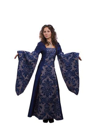 medieval dress: Mujer con un vestido azul de lujo en Halloween. Una mujer joven vestida como princesa. Linda chica en traje de �poca medieval sobre fondo blanco.