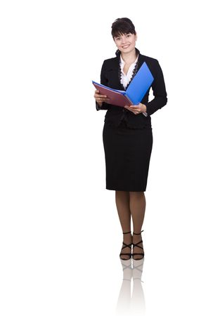 Happy successful business woman is holding folders . Young business girl with documents. Isolated over white background. Foto de archivo