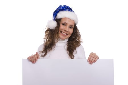 informational: Young woman in a santa costume holding a blank informational sign. Girl with Santas hat holding blank sign on a white background.  Female dressing up in blue Christmas over a banner add or billboard.