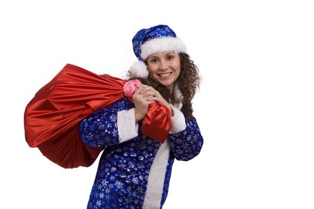 Santa woman dressing up in blue Christmas costume is holding red sack with gifts. Beautiful Snow Maiden holding a Christmas bag full of presents. photo