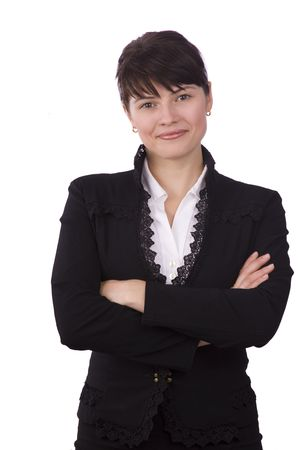 Serious business woman with brown hair is standing. Brunette businesswoman dressed in black suit. Isolated over white background.