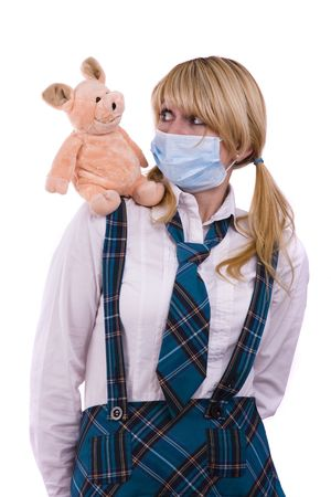 Pig flu virus.  Schoolgirl is wearing surgical mask and is afraid of pig. Young woman with respiratory mask and pig is sitting on her shoulder. Picture is symbolizing swine flu or influenza AH1N1 virus photo