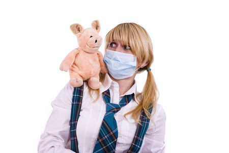 ah1n1: Pig flu virus.  Schoolgirl is wearing surgical mask and is afraid of pig. Young woman with respiratory mask and pig is sitting on her shoulder. Picture is symbolizing swine flu or influenza AH1N1 virus