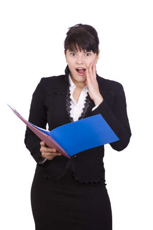 anguished: Business women looks up from finances account with an anguished expression on her face. A pretty brunette businesswoman is shocked by the finances report. Isolated over white background.