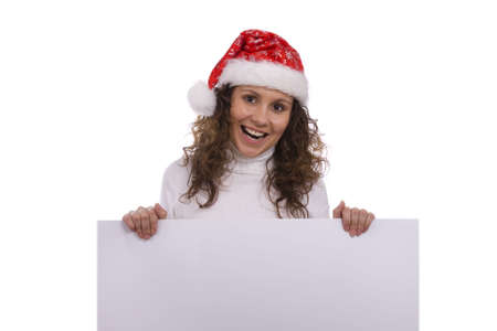 informational: Young woman in a santa costume holding a blank informational sign. Girl with Santas hat holding blank sign on a white background.  Female dressing up in red Christmas over a banner add or billboard.
