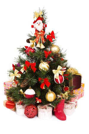 Christmas tree with baubles, balls and bows ornaments and gifts. A lovely traditional Christmas tree decorated in red and gold color. photo