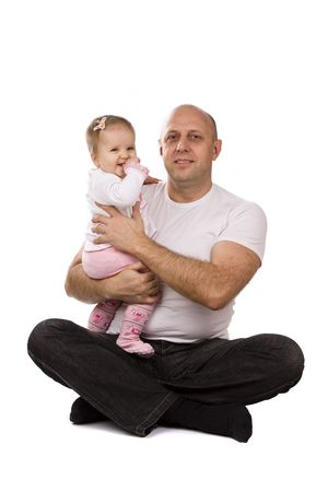 Father and little daughter are sitting on the floor.  photo