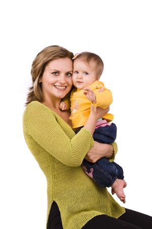 Happy family. Mother and little daughter are smiling . Woman and baby are hugging and posing happily on white background photo