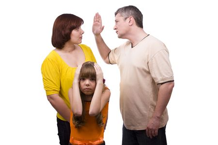 Husband is striking wife.  Parents swear, and children suffer. Girl suffers while parents argue vehemently in white background.  Couple fighting Foto de archivo