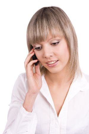 Smiling girl speaks on the mobile phone. Happy woman on the phone, must have been some pretty good news. Young female on cellphone. Stock Photo - 6228058