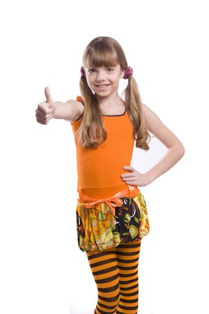 Little girl in the orange dress is showing thumbs up on white background. Portrait of an attractive young teenage rmake gesture ok in orange over white background. photo