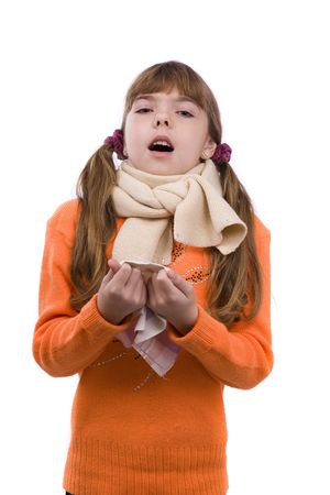 Sneezing. Little girl on white background in winter clothing is sick. Female have sore throat and sneezing.