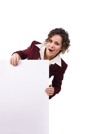 Portrait of a happy businesswoman holding white blank card against isolated white background. A beautiful young woman is holding a blank white sign. Business woman standing beside a billboard photo