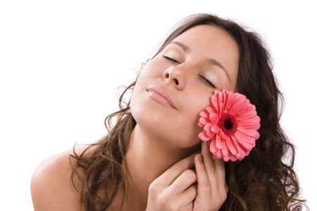 Portrait of beautiful woman before spa treatment. Beautiful female with pink flower. photo