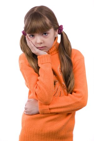 Blond young girl with toothache on white background.