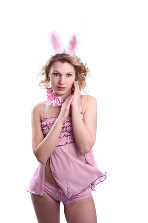 Woman wearing fancy dress on Halloween. A young female dressed up as rabbit Cute girl in sexy playboy costume on white backgrounds. photo