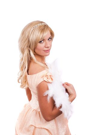 Woman wearing fancy peach-coloured dress on Halloween. A young woman dressed up as princess. Cute girl in medieval era costume on white background. Stock Photo
