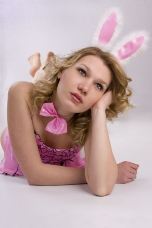 Woman wearing fancy dress on Halloween. A young female dressed up as rabbit Cute girl in sexy playboy costume on white backgrounds.