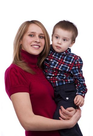 Happy family. Mother and little son  are smiling . Woman and boy are hugging and posing happily on white background photo