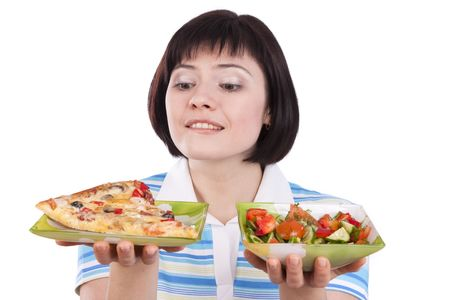 Woman makes choice between pizza and healthy salad on white background.  To eat or not to eat Standard-Bild
