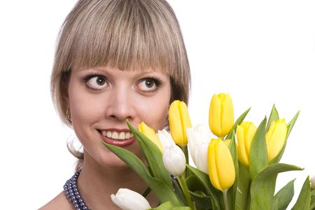 Woman with flowers.  Picture of happy blond with and yellow tulips.  Spring beauty. Pretty young female holding bouquet of tulips isolated on white background .  photo