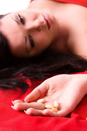 Suicide. Overdose of drugs. Woman suicide with pills photo