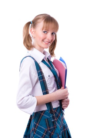 A young and beautiful schoolgirl  is wearing a traditional uniform is holding folders on white background. Senior high school student in uniform with documents. photo