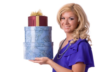 Beautiful smiling woman with a gift. Girl in purple dress is standing and holding purple box with gold ribbon on white background. Stock Photo - 7169851