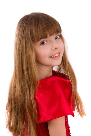 Close-up portrait of a beautiful blond girl. Little girl is wearing in red dress.