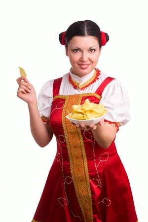 GermanBavarian girl with a traditional Oktoberfest Ma?krug. Smiling woman in red drindl is holding a potato chips. Young woman dressed in a Bavarian dirndl. photo
