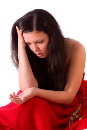 Very sad woman suffers and struggles because of infidelity. Girl feeling sad, depressed, grief. Distraught woman is very upset and holding gold wedding ring.