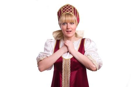 kokoshnik: Girl standing in Russian traditional costume. Woman is wearing sarafan and kokoshnik . The girl in red old russian dress. Isolated on white. Stock Photo