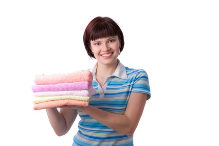 Housewife with clean laundry.  A young woman holding clean towels. Time for laundry day.    photo