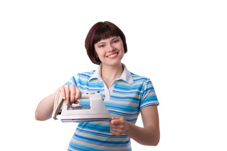 Woman with electric iron.  Beutiful housewife ironing clothes. Housekeeper concept. Stock Photo - 7228373