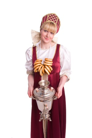 Woman in Russian traditional costume with bread-ring and samovar  photo