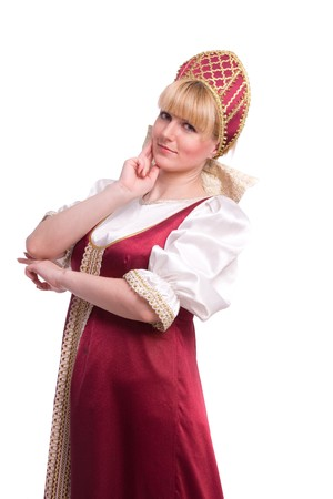 kokoshnik: Girl standing in Russian traditional costume. Woman is wearing sarafan and kokoshnik . The girl in red old russian dress. Isolated on white. Stock Photo