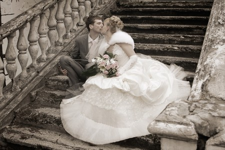 Romantic image of attractive couple. Smiling Newlywed Couple on Wedding Day.newly wed couple enjoy their time. Just married! photo