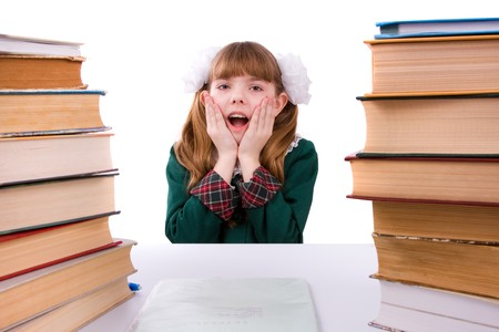 Senior high school student in uniform is sitting on the stack of book and study up. Young and beautiful schoolgirl  is wearing a traditional uniform is shocked by something. Stock Photo - 7310350