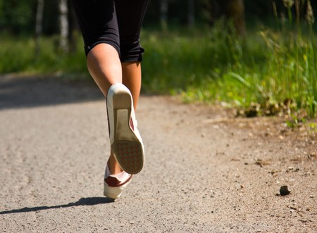 stamina: Girl running in the park. Active woman running. A confident female runner has the stamina to conquer all.