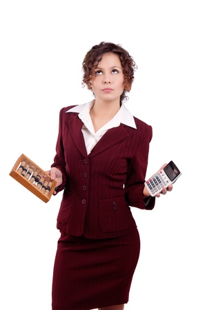 business woman holding abacus and calculator. photo
