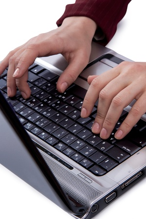 Women typing on keyboard photo