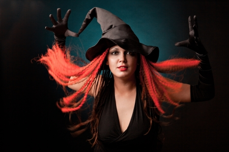 Witch practises witchcraft on black background