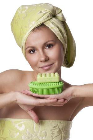 Beautiful girl in a green towel keeps bath