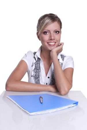 Business woman sitting at table with documents