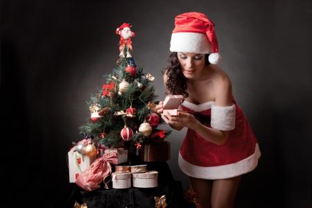 Santa girl open the gift  Stock Photo