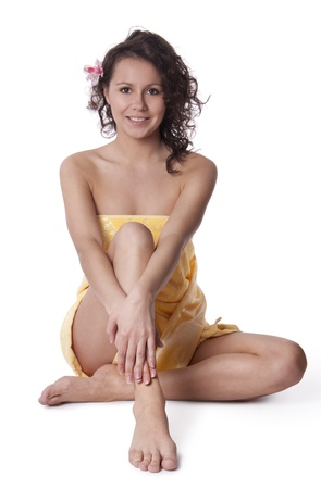 Beautiful woman, wrapped a towel sitting Stock Photo