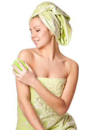 Woman in a towel does massage brush