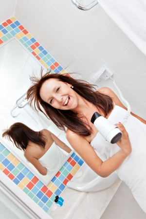 Woman hairdrying Stock Photo